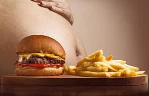 Best Supplement for Energy and Concentration - Burger and Fries in Front of Fat Tummy