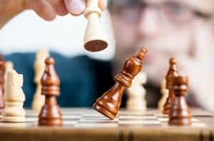 The Best Memory Supplements for Seniors - Chess Player Taking a Pawn