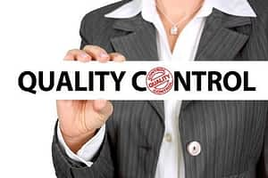 What's the Best Nootropic for Athletes - Business Woman Holding Quality Control Sign
