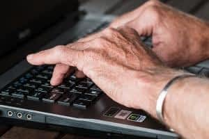 The Best Memory Supplements for Seniors - Elderly Man's Hands Typing