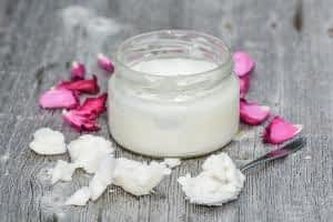 How does CoQ10 Benefit the Brain - Coconut Oil on a Table