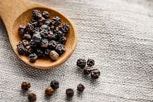 Awaken Gold Review - Black Peppercorns in a Spoon