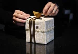 How does CoQ10 Benefit the Brain - Man Wrapping a Present