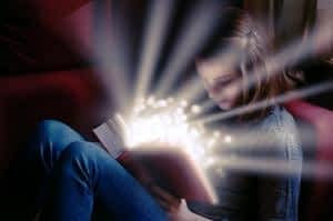 Phosphatidylserine and Sleep - What's the Connection - Girl Reading Glowing Book