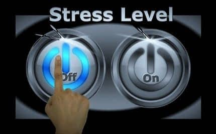 Awaken Gold Review - Finger Pressing Off Button to Stop Stress Machine