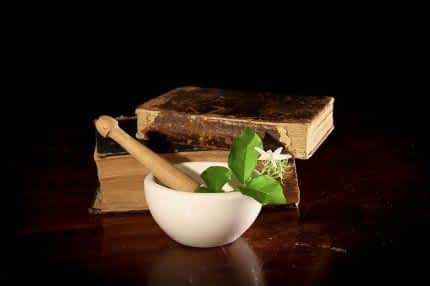 Mortar and pestle with herbs.