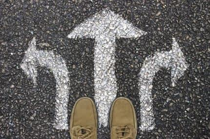 Three arrows on ground pointing in different directions.