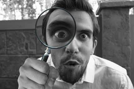 Best Supplement for Energy and Concentration - Man Inspecting Further with Magnifying Glass