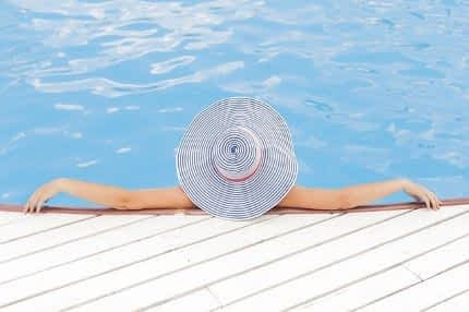 Awaken Gold Review - Woman Relaxing by a Pool
