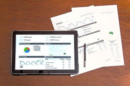 Market analytics on a tablet screen.