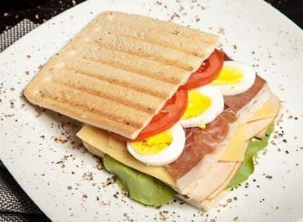 Sandwich stacked with ingredients.