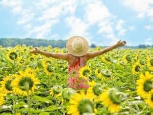 Is Black Pepper a Nootropic - Happy Woman in Sunflower Field