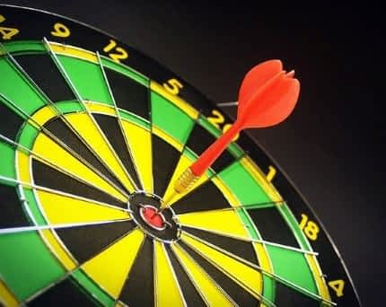A dart in the bullseye of a dartboard.