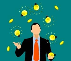 How does CoQ10 Benefit the Brain - Man Juggling Light Bulbs and Coins