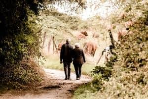 How does CoQ10 Benefit the Brain - Senior Couple Walking in Park