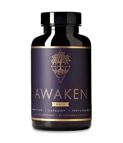 Bottle of Awaken Gold nootropic supplement.