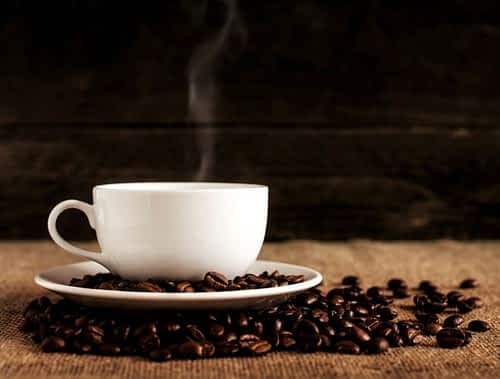 Does Caffeine Help with Focus - Steaming Cup of Coffee